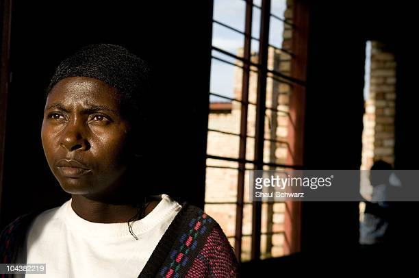 Mukakabanda Julitte a survivor of the genocide who lost her family at Murambi and today works in the Murambi memorial center stands for a portrait in...