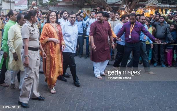 Mukesh Ambani along with his wife Nita Ambani and son Anant Ambani visits Siddhivinayak temple to offer the first wedding invitation of Aakash...