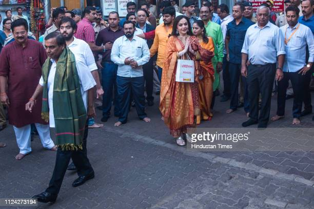 Mukesh Ambani along with his wife Nita Ambani and son Anant Ambani visits Siddhivinayak temple to offer the first wedding invitation of Aakash...