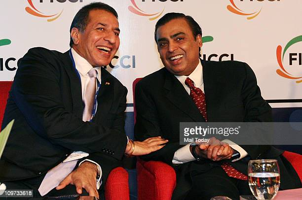 Mukesh Ambani Chairman and Managing Director of Reliance Industries with ViceChairman and Managing Director of Bharti Enterprises Rajan Bharti Mittal...
