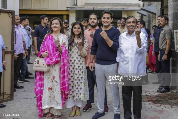 Mukesh Ambani chairman and managing director of Reliance Industries Ltd from right his sons Akash Ambani and Anant Ambani his daughter Isha Ambani...