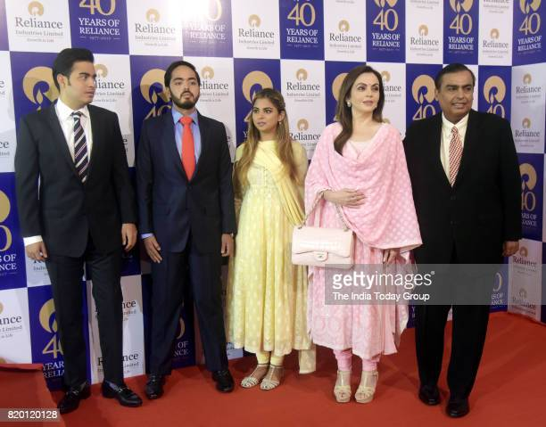 Mukesh Ambani Nita Ambani Akash Ambani Anant Ambani Isha Ambani and Kokilaben at the company's 40th Annual General Meeting in Mumbai