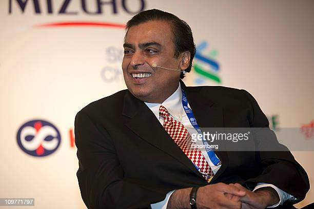 Mukesh D Ambani chairman of Reliance Industries Ltd smiles at the Institute of International Finance Spring Membership Meeting in New Delhi India on...