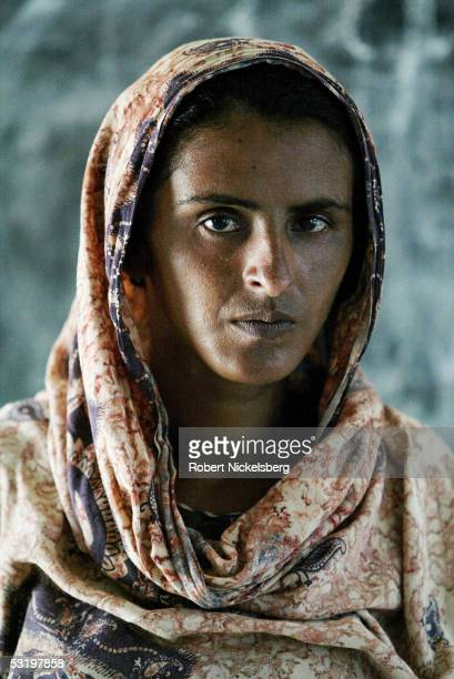 Mukhtiar Mai who was gang raped by 6 men from a more powerful clan living next door on June 22 poses August 25 2004 in Jatoimeerwala Pakistan She had...