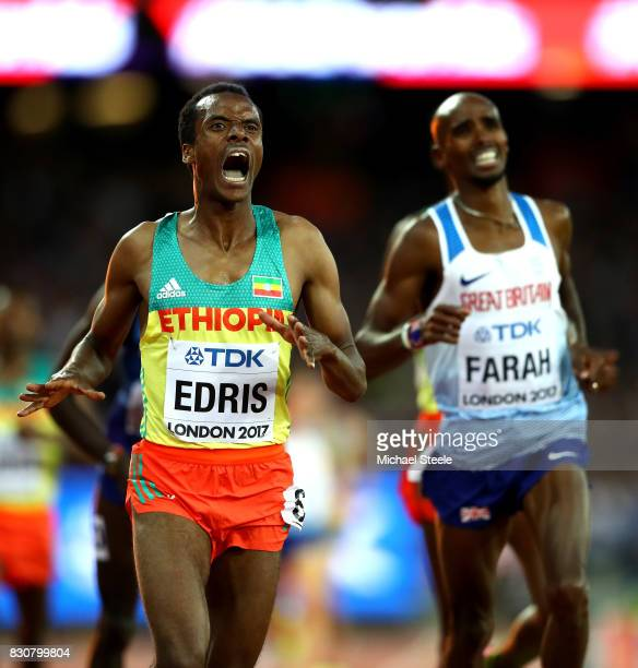 Muktar Edris of Ethiopia and Mohamed Farah of Great Britain cross the finishline in the Men's 5000 Metres final during day nine of the 16th IAAF...