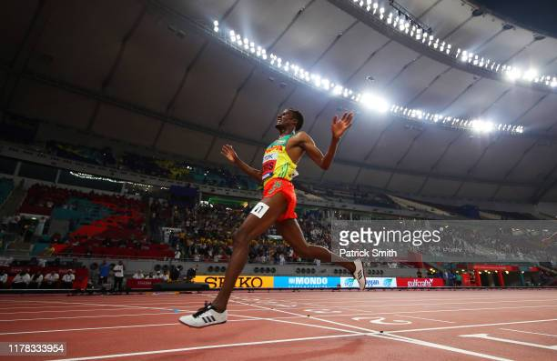 Muktar Edris of Ethiopia crosses the line to win gold in the Men's 5000 metres final during day four of 17th IAAF World Athletics Championships Doha...