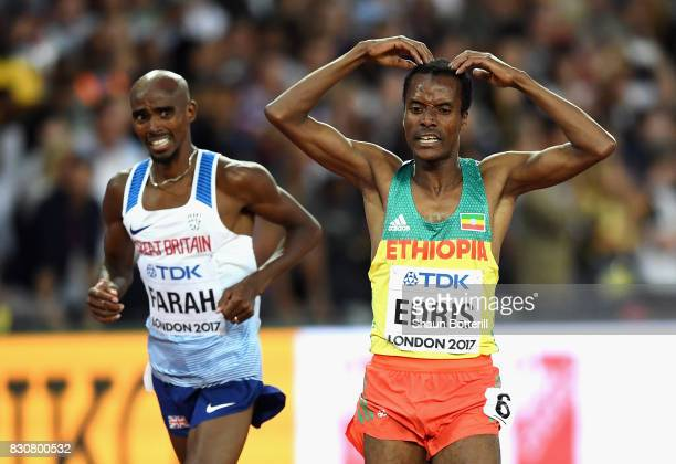 Muktar Edris of Ethiopia does the 'Mobot' as Mohamed Farah of Great Britain looks on after crossing the finishline in the Men's 5000 Metres final...