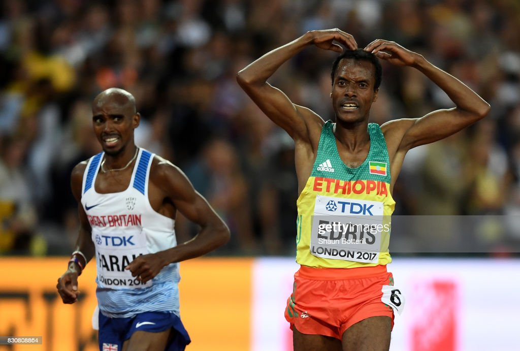 Muktar Edris of Ethiopia does the 'Mobot' as Mohamed Farah of Great Britain looks on after crossing the finishline in the Men's 5000 Metres final during day nine of the 16th IAAF World Athletics Championships London 2017 at The London Stadium on August 12, 2017 in London, United Kingdom.
