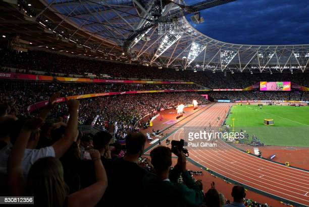 """Muktar Edris of Ethiopia does the """"Mobot"""" as Mohamed Farah of Great Britain looks on after crossing the finishline in the Men's 5000 Metres final..."""