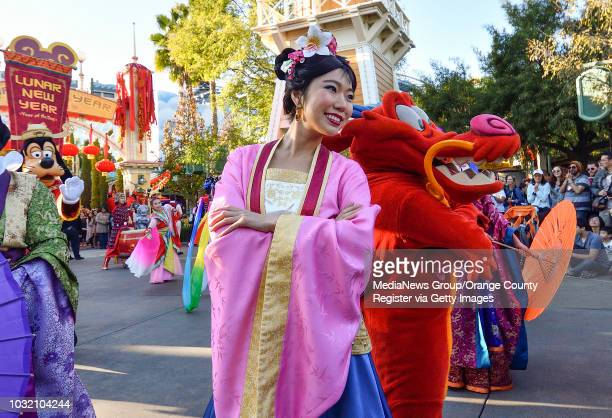 Mulan and Mushu join dancers as they perform during Mulan's Lunar New Year Procession on the first day of Disney's Lunar New Year celebration at...