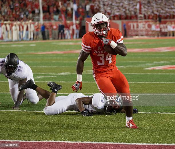 Mulbah Car of the Houston Cougars scores on a six yard rush against the Tulsa Golden Hurricane in the first half on October 15, 2016 in Houston,...