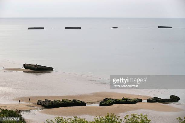 Mulberry Harbours are exposed at low tide on May 5 2014 in Arromanches France The artificial military harbours were towed across the English Channel...