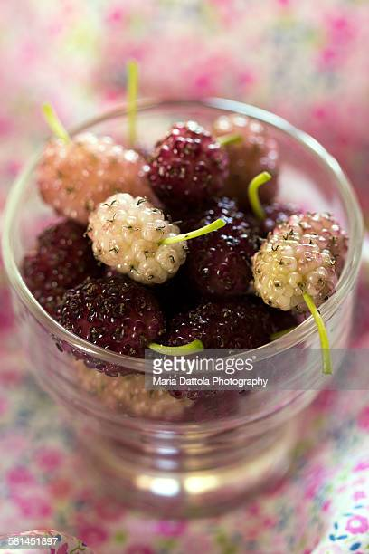 Mulberry in glass cup.
