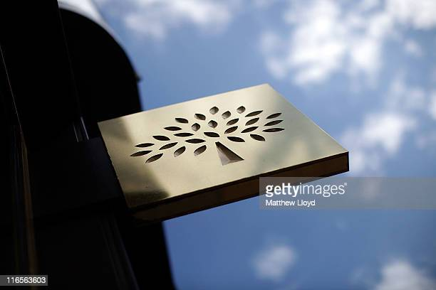 Mulberry's distinctive logo on a sign hanging outside their flagship retail store on New Bond Street on June 16, 2011 in London, England. The luxury...