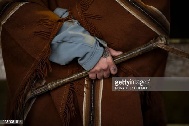Muleteer holds his rebenque at the Liniers Cattle Market in Buenos Aires, on July 1, 2021. - The Liniers Cattle Market moves to Canuelas, Buenos...