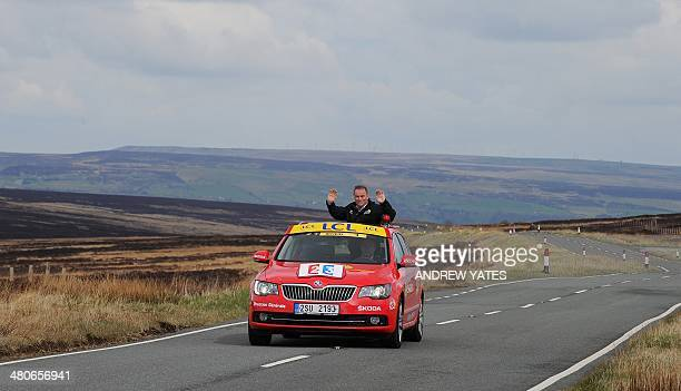 Muli time Tour De France winner Bernard Hinault takes a ride in the offical Tour De France car up Cragg Vale Englands longest continuous uphill climb...