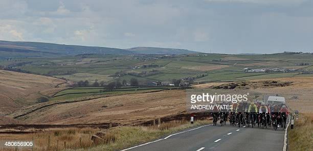 Muli time Tour De France winner French former cyclist Bernard Hinault leads a group of local cyclists up Cragg Vale Englands longest continuous...