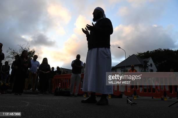 TOPSHOT Mulim cleric Mufti Zeeyad Ravat leads a prayer near the Al Noor mosque in Christchurch on March 19 2019 New Zealand Prime Minister Jacinda...