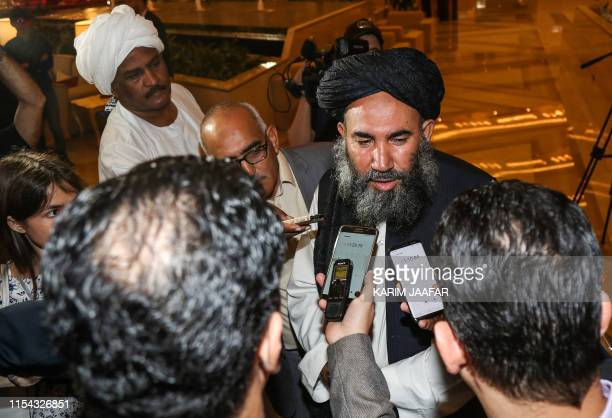 Mullah Abdul Salam Zaeef senior official of the Afghan Taliban and former envoy to Pakistan speaks to reporters during the Intra Afghan Dialogue...
