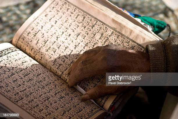 CONTENT] Mullah's hand is seen here resting on the Quran at the tomb of Shahzada Abdullah Herat Afghanistan Quran is the holy book of Islam and...