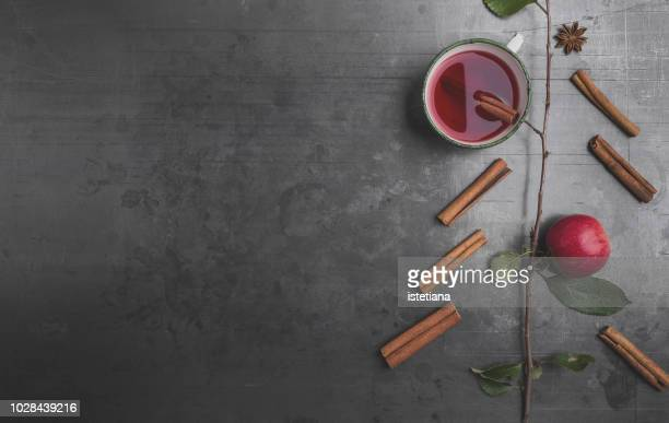 Mulled wine apple cider with cinnamon stick and apple branch