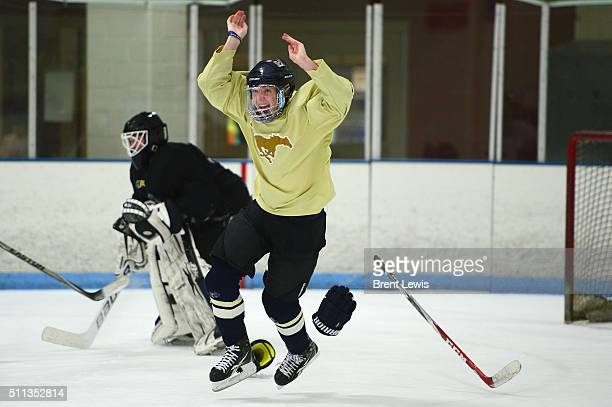 Mullen High School's Eli Mills celebrates after making the last goal of pratice at Edge Ice Arena on February 17 2016 in Littleton Colorado Hockey...