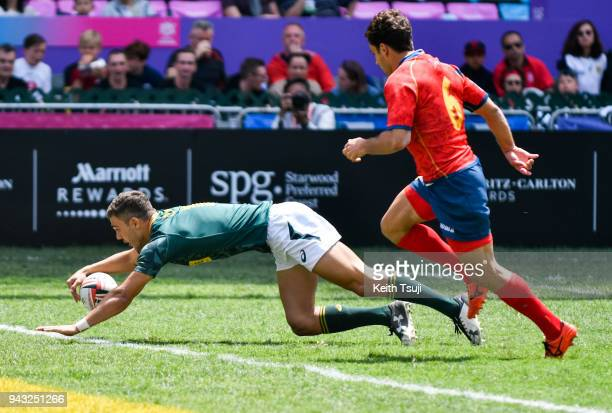 Muller du Plessis of South Africa dives in to score a try in the Quarterfinal match against Spain during the Hong Kong Sevens on April 8 2018 in Hong...