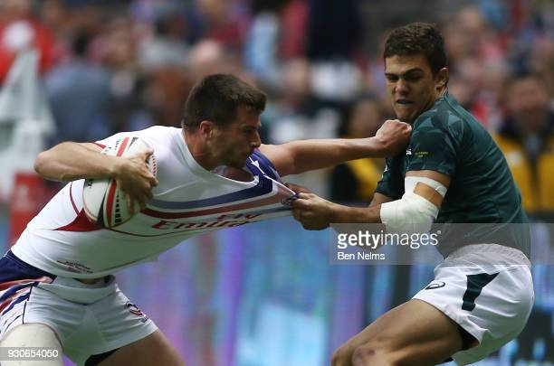 Muller du Plessis of South Africa grabs Nick Boyer of the United States during the bronze medal game at Canada Sevens the Sixth round of the HSBC...