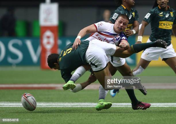 Muller du Plessis of South Africa is tackled by Cody Melphy of the United States during the bronze medal game at Canada Sevens the Sixth round of the...