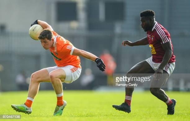 Mullingar Ireland 9 June 2018 Patrick Burns of Armagh in action against Boidu Sayeh of Westmeath during the GAA Football AllIreland Senior...