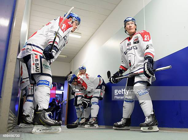 Mulock and Antti Miettinen of the Eisbaeren Berlin seen prior the game between Thomas Sabo Ice Tigers and Eisbaeren Berlin on November 23, 2014...