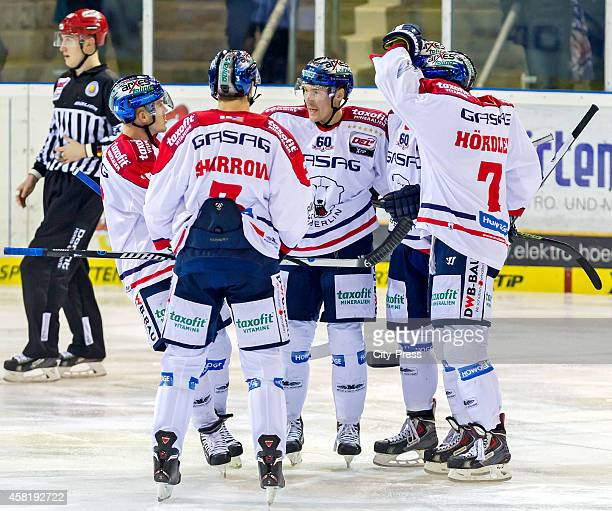 Mulock, Jimmy Sharrow, Andre Rankel and Frank Hoerdler of the Eisbaeren Berlin celebrate after scoring the 1:1 during the game between Straubing...