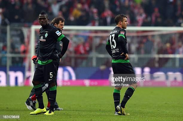 Mulongoti and Lukas Schmitz of Bremen look dejected after the Bundesliga match between Bayern Muenchen and Werder Bremen at Allianz Arena on February...