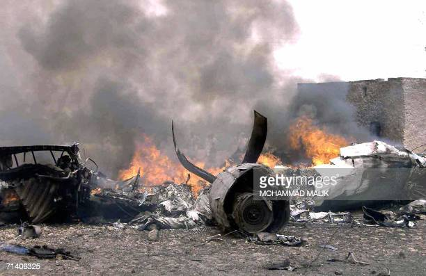 Flames rise at the crash site of a Pakistan International Airlines plane in Multan 10 July 2006 A Pakistan International Airlines plane crashed into...