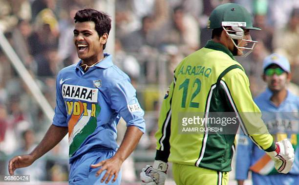 Indian cricketer Rudra Pratap Singh celebrates after he dismissed Pakistan's Abdul Razzaq during the fourth One Day International match between...