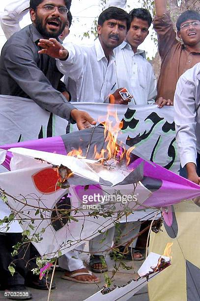 Pakistani activists from a student wing of the Islamic party JamaateIslami hold kites and chant slogans during a protest in Multan 09 March 2006...