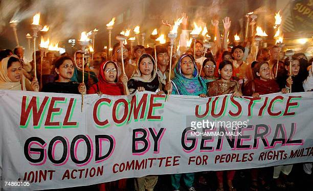 Pakistani activists of the Joint Action Committee for People's Rights carry lit torches in solidarity with suspended Chief Justice Iftikhar Muhammad...