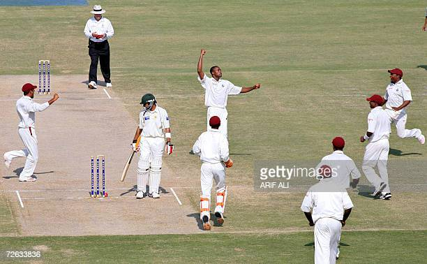 West Indies cricketers celebrate the dismissal of Pakistan batsman Shoaib Malik during the fifth and last day of the second cricket Test match...