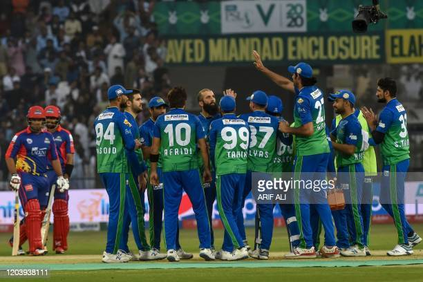 Multan Sultans' cricketers celebrate after the dismissal of Karachi Kings' Sharjeel Khan during the Pakistan Super League T20 cricket match between...