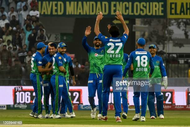 Multan Sultans' cricketers celebrate the dismissal of Karachi Kings' Babar Azam during the Pakistan Super League T20 cricket match between Karachi...