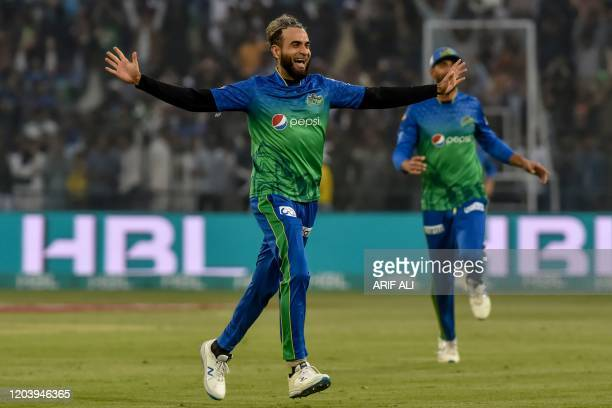 Multan Sultans' Imran Tahir celebrates after taking the wicket of Karachi Kings' Cameron Delport during the Pakistan Super League T20 cricket match...