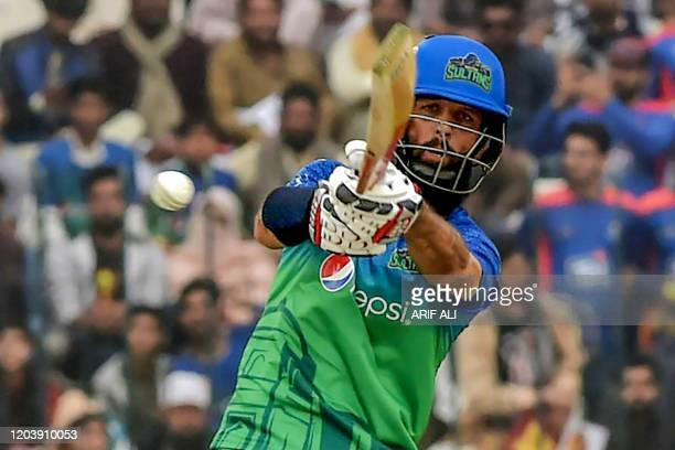 Multan Sultans' Moeen Ali plays a shot during the Pakistan Super League T20 cricket match between Karachi Kings and Multan Sultans at the Multan...