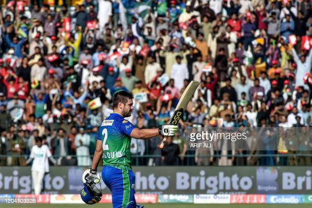 Multan Sultans' Rilee Rossouw raises his bat after scoring a century during the Pakistan Super League T20 cricket match between Multan Sultans and...