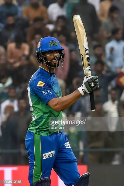 Multan Sultans' team captain Shan Masood celebrates after scoring a half century during the Pakistan Super League T20 cricket match between Karachi...