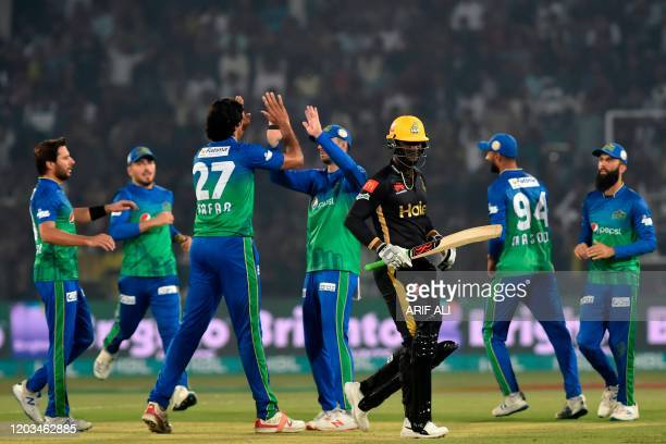 Multan Sultans's cricketers celebrate after the dismissal of Peshawar Zalmi's captain Darren Sammy during the Pakistan Super League Twenty20 cricket...