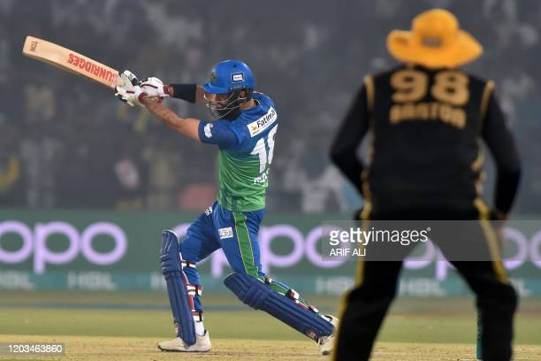 Multan Sultans's Moeen Ali plays a shot during the Pakistan Super League Twenty20 cricket match between Multan Sultans and Peshawar Zalmi at the...