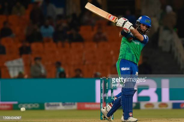 Multan Sultans's Moeen Ali plays a shot during the Pakistan Super League T20 cricket match between Karachi Kings and Multan Sultans at the Gaddafi...