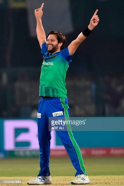 Multan Sultans's Shahid Afridi celebrates after taking the wicket of Peshawar Zalmi's Liam Dawson during the Pakistan Super League Twenty20 cricket...