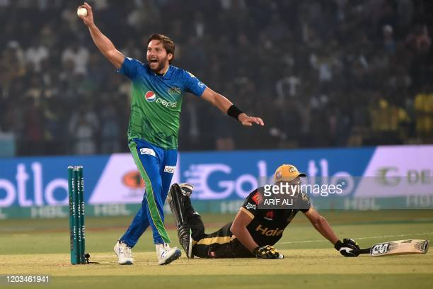 Multan Sultans's Shahid Afridi makes an appeal for a runout against Peshawar Zalmi's Wahab Riaz during the Pakistan Super League Twenty20 cricket...