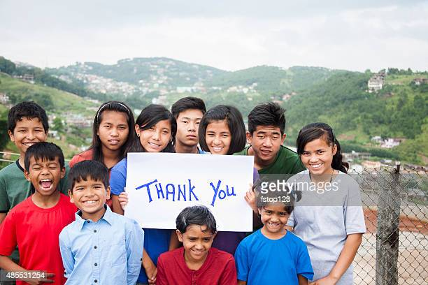 """mult-ethnic, large group of children hold """"thank you"""" sign outdoors. - thank you phrase stock pictures, royalty-free photos & images"""